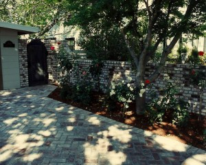 Landscape Architect designed brick driveway and garden wall
